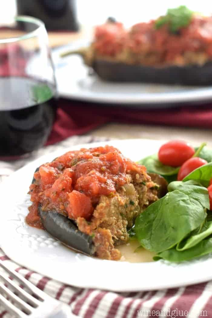 This Stuffed Eggplant is an old family favorite. Tender eggplant and spicy sausage topped with homemade red sauce, this hearty dish is stuffed with flavor!