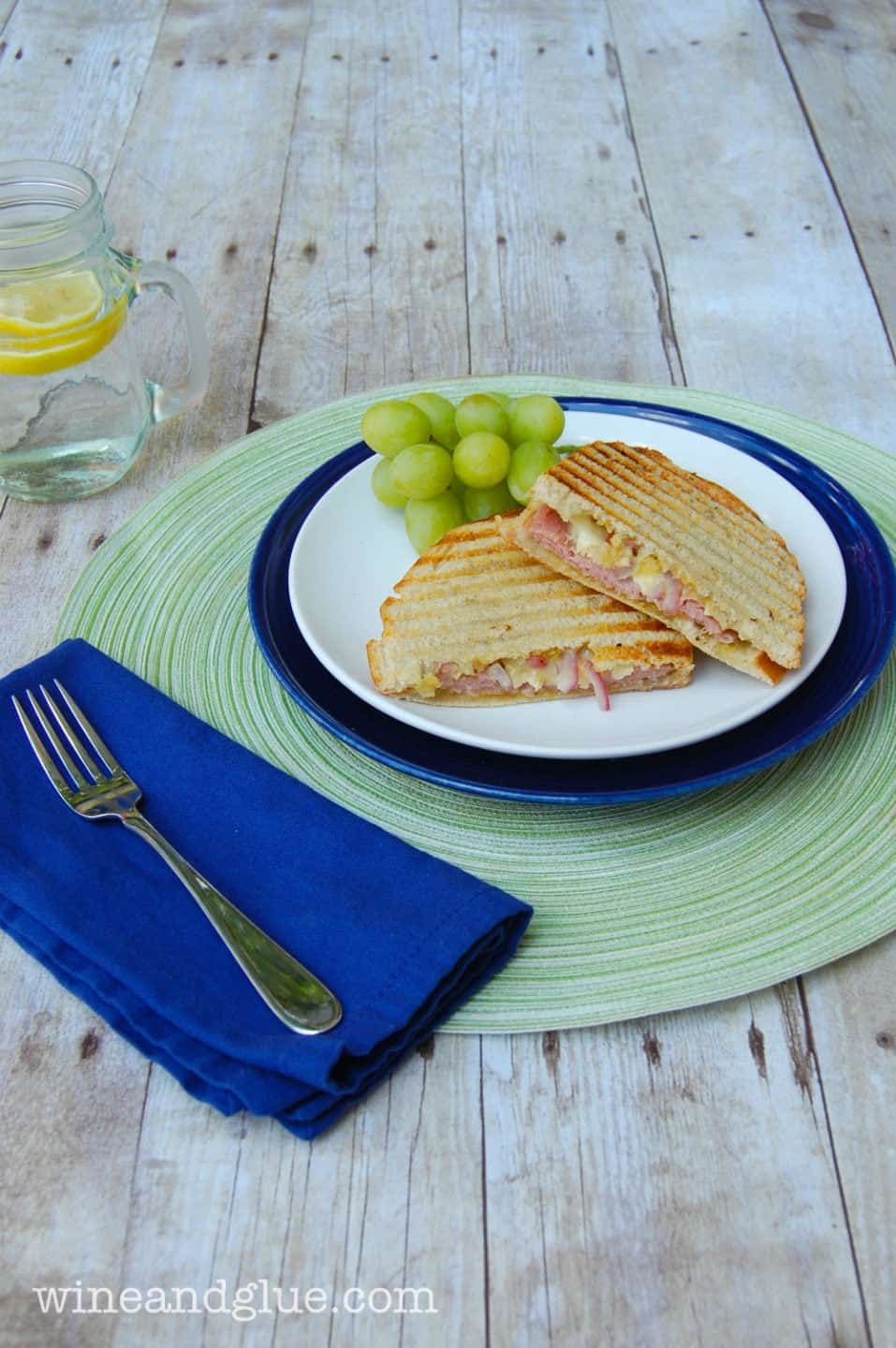 Ham and Brie Panini mixes the most delicious flavors into an easy panini that will make you feel like you are having lunch in a fancy cafe via www.wineandglue.com