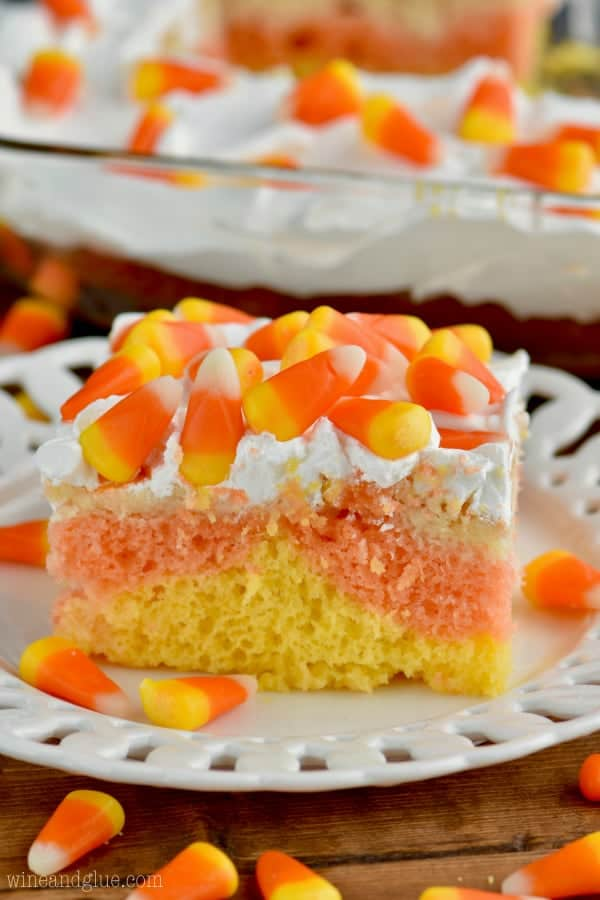 Candy Corn Poke Cake!  The perfect Halloween dessert that is super easy to make but has a big wow factor!!
