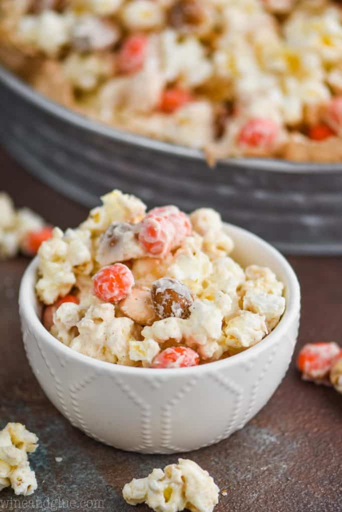 a small bowl full of a white chocolate popcorn recipe