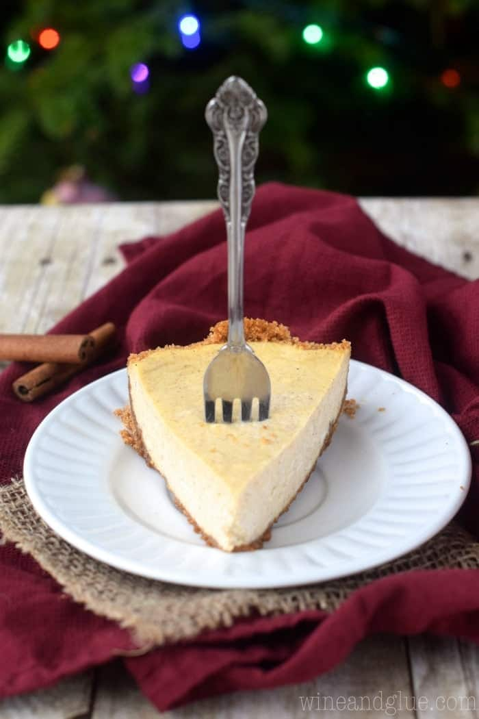 Delicious Eggnog Cheesecake with a perfect Cinnamon Graham Cracker Crust!