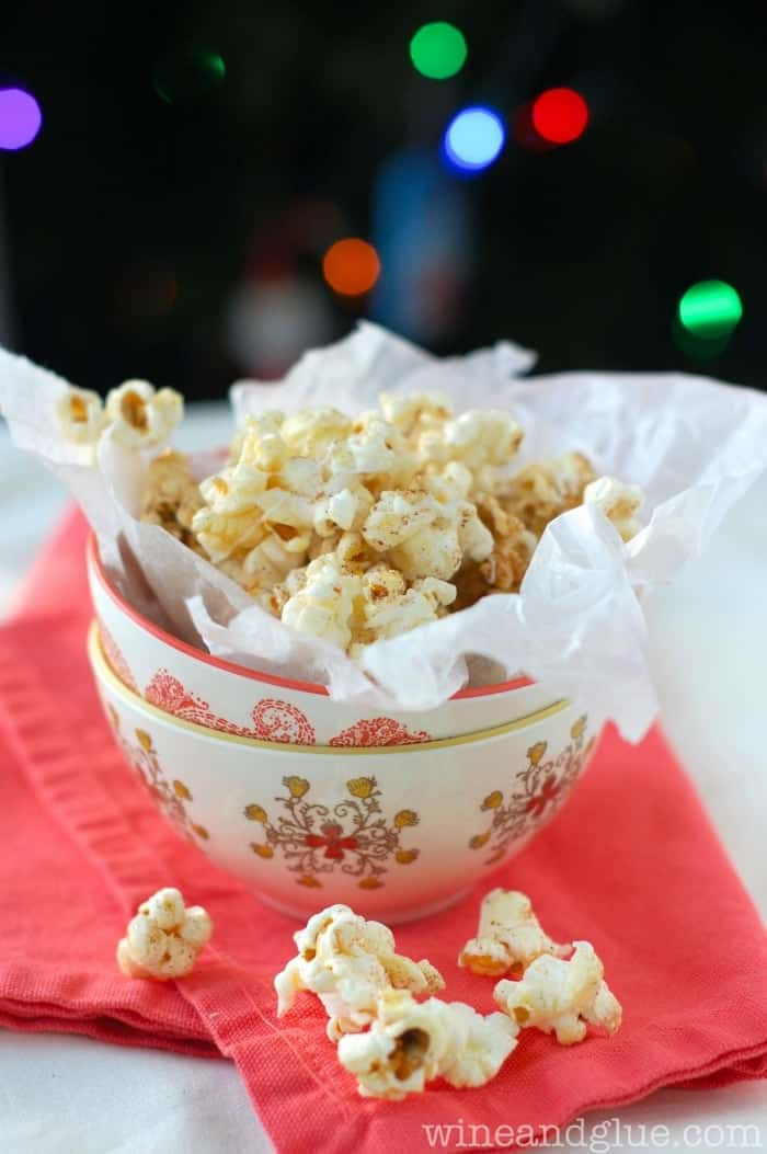 A bowl of seasoned gingerbread kettle corn drizzled with white chocolate