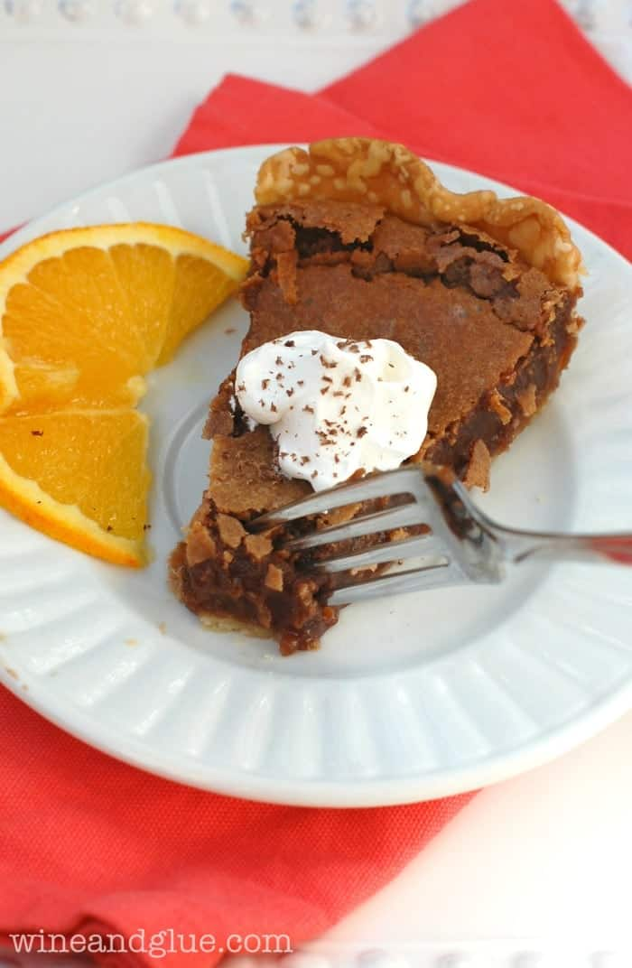 Nutella Pie on a plate with an orange slice garnish.