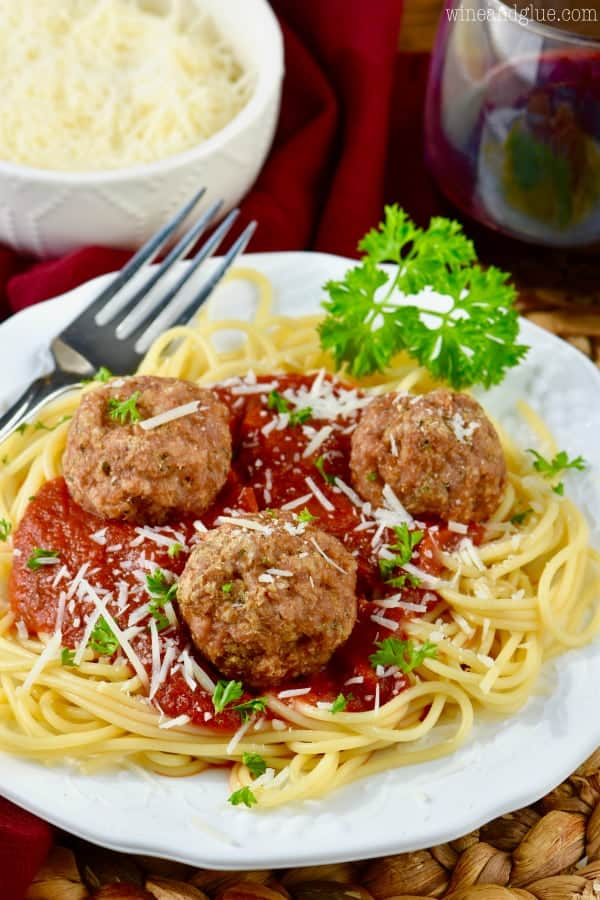 Healthy meatballs on top of spaghetti and marinara sauce.