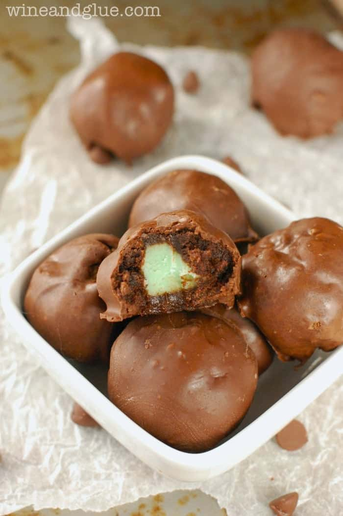 Mint Creme Brownie Bombs | www.wineandglue.com | Irresistible brownie truffles filled with mint creme!