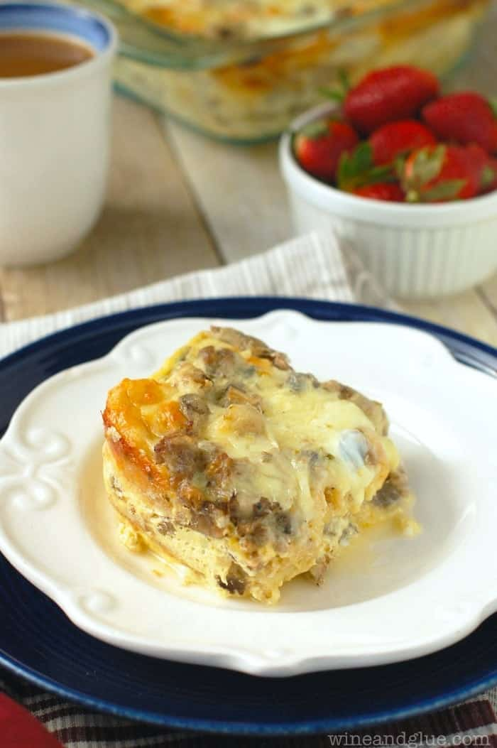 white plate with sausage and mushroom breakfast strata