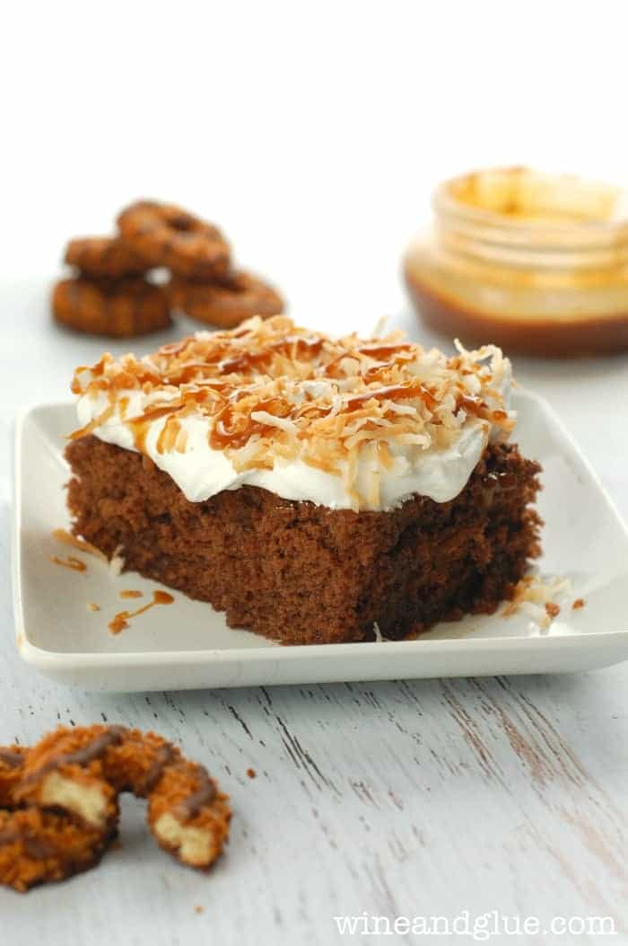This Samoas Poke Cake inspired by Samoas Girl Scout Cookies is my new favorite!  Totally irresistible!