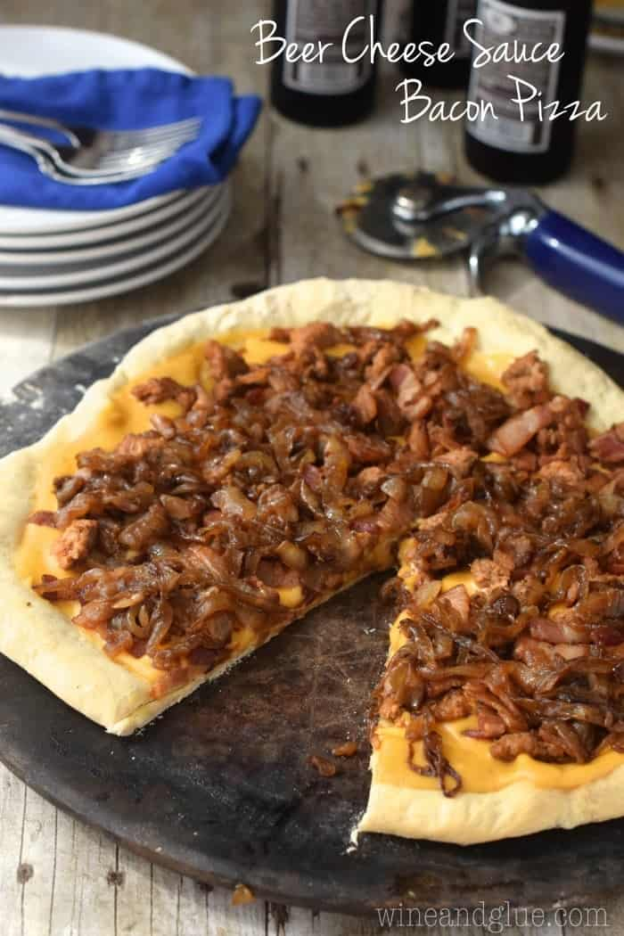 Beer Cheese Sauce pilled high with spicy sausage, bacon, and caramelized onions!