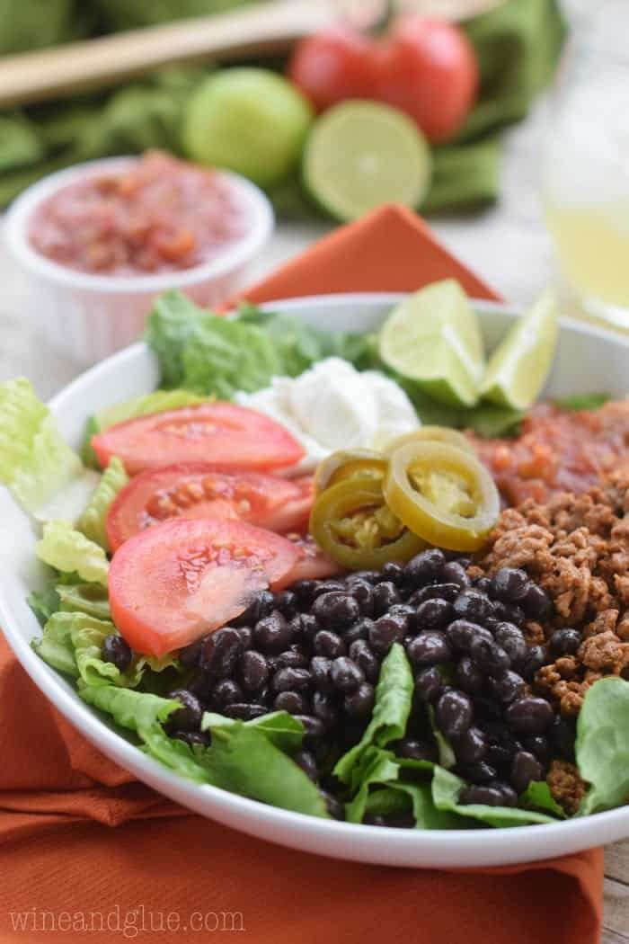 taco salad ingredients on white plate