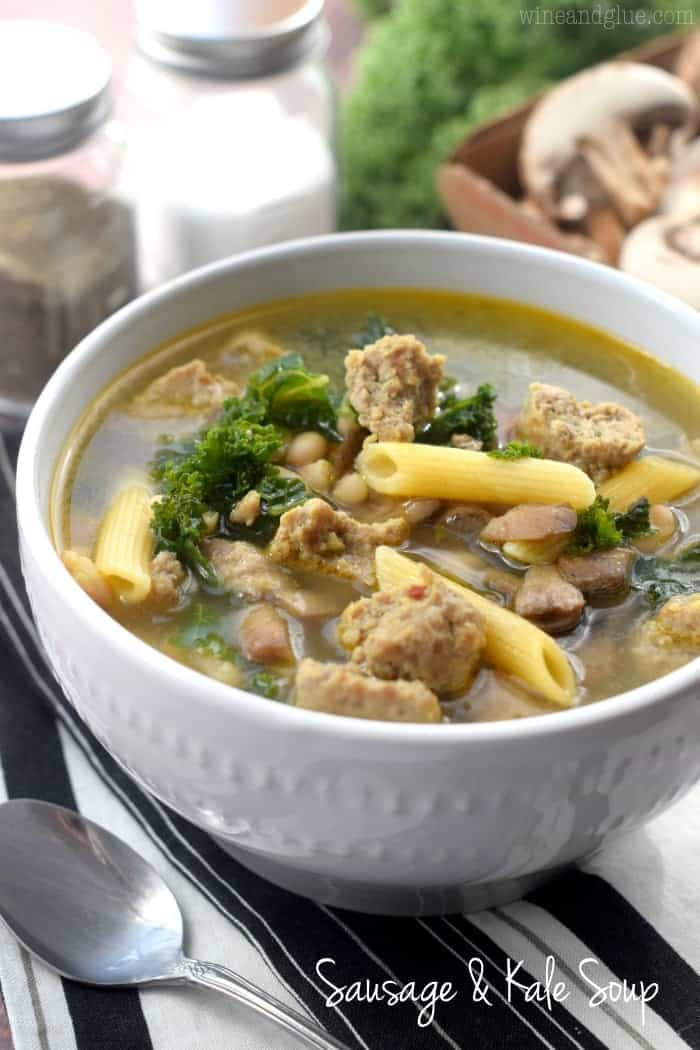 white bowl of sausage and kale soup