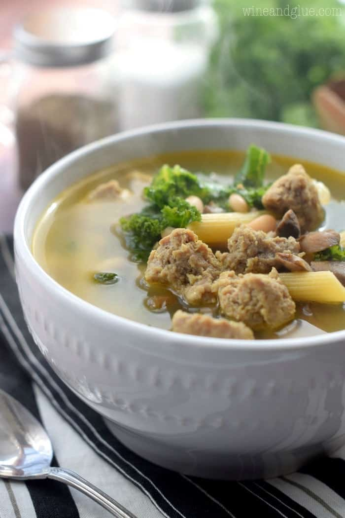 whit bowl of sausage and kale soup