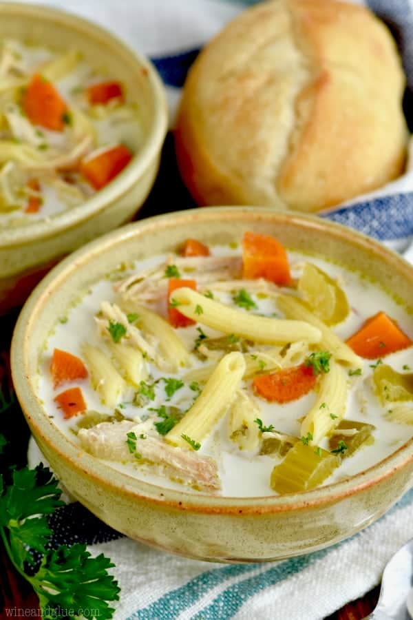Our family loves this easy slow cooker chicken noodle soup! It is creamy and delicious!