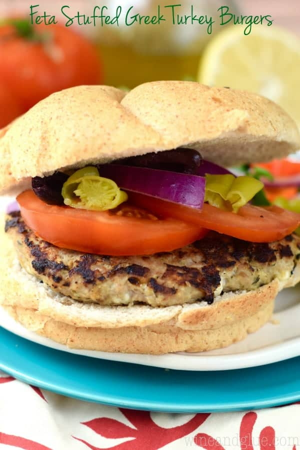 These Feta Stuffed Greek Turkey Burgers are PACKED with amazing flavor!  They are perfect for summer grilling!