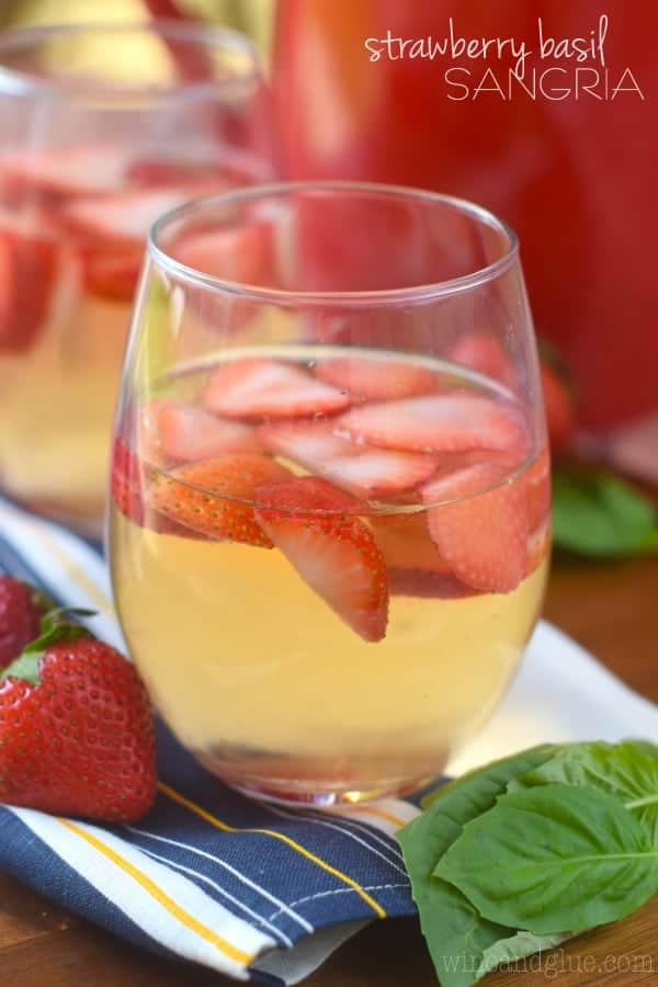 Such a perfect and easy summer cocktail! This Strawberry Basil Sangria is exactly what your summer BBQ or picnic needs!