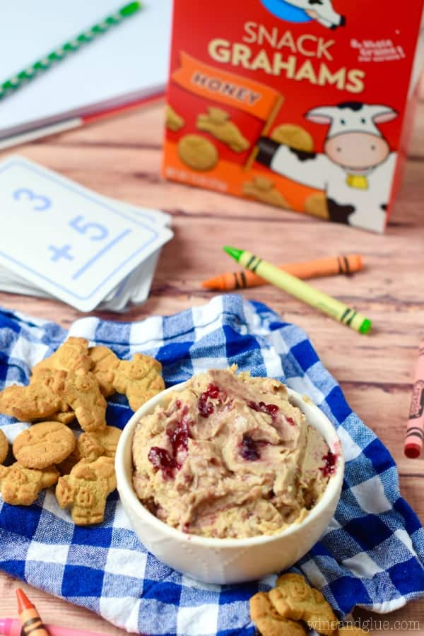 This Peanut Butter and Jelly Dip is a fun snack for the kiddos that whips up really fast and is a snack that you can feel good about.