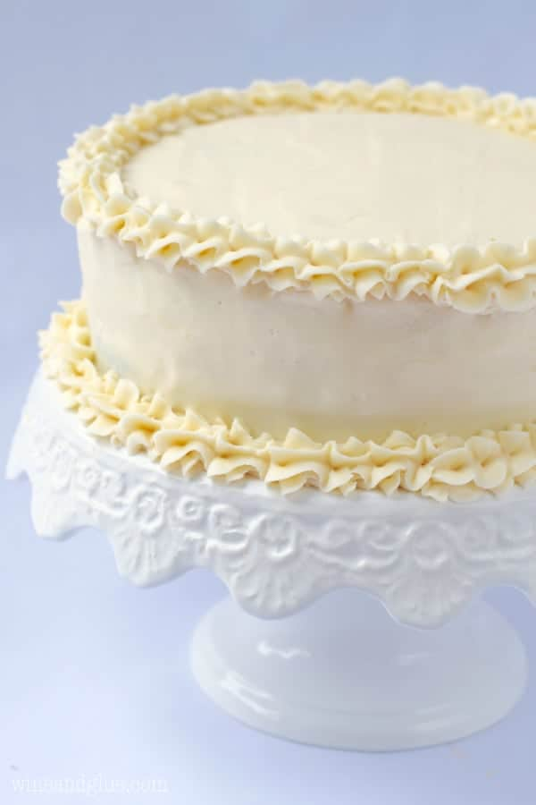 Layer cake iced with the BEST Vanilla Buttercream Frosting. Give it a try, you'll never want cake without it again. Or spoons.