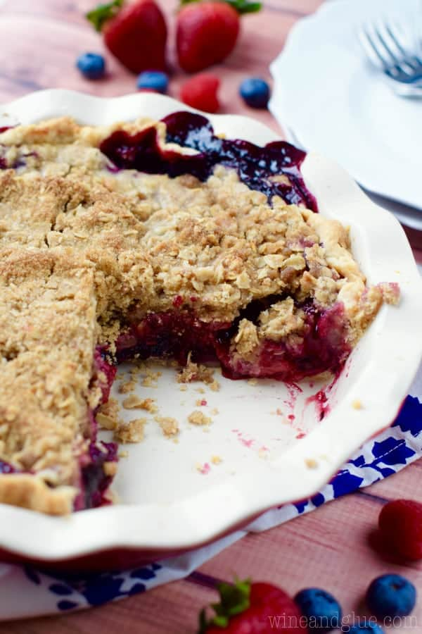 This Triple Berry Cobbler Pie combines the amazing flavors of blueberry, raspberry, and strawberries in an amazing pie with a crumble topping. It's like a cobbler and a pie combined, so good!