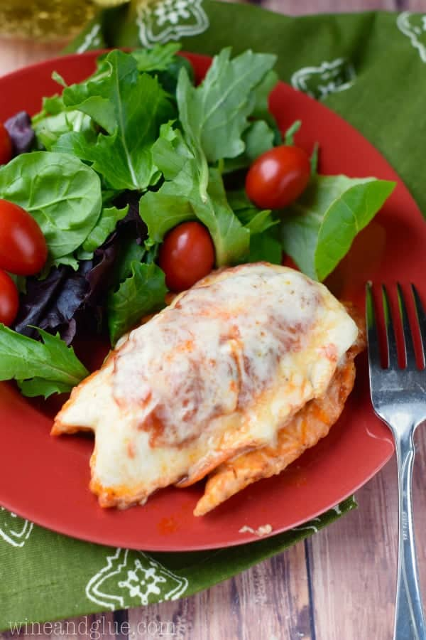 This Pizza Stuffed Chicken is such a fun twist on an ordinary baked chicken dinner and would be super easy to switch up with all of your favorite pizza toppings!