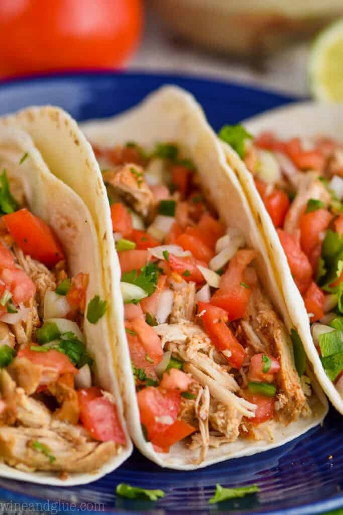 upclose picture of a chicken taco garnished with pico de Gallo