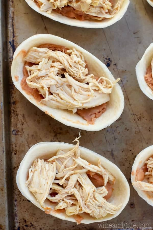 Taco Boats filled with refried beans and shredded chicken