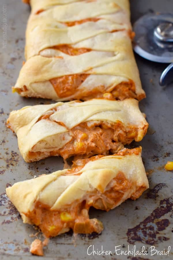 Chicken Enchilada Crescent Braid cut into strips on a pan.