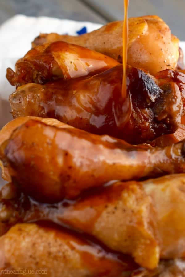 These Slow Cooker Honey BBQ Chicken Drumsticks are WAY EASY, but so delicious! Serve them on gameday or for an easy family dinner!