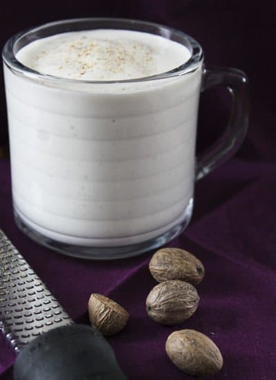 The Banana Nutmeg Smoothie has a white color with powdered nutmeg on top.