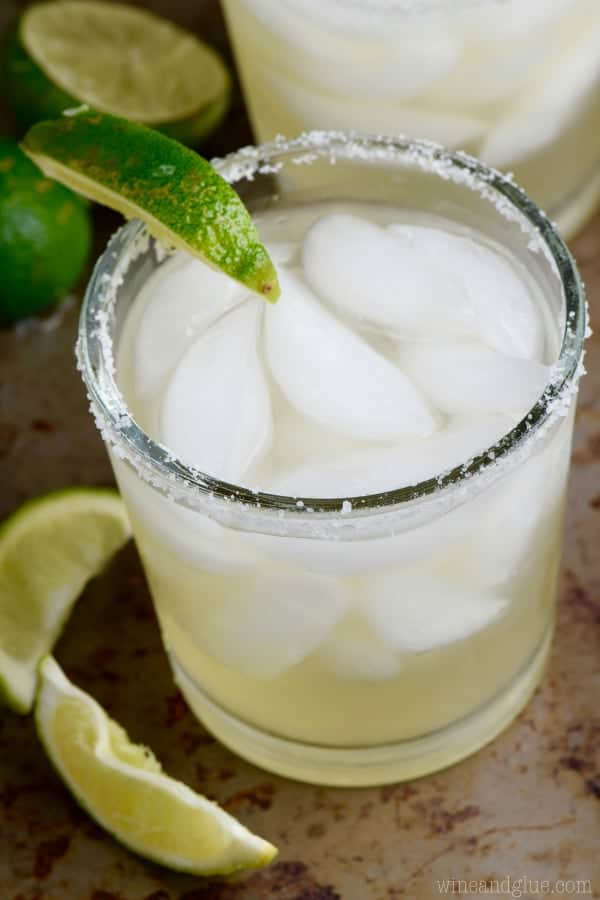 This is hands down the BEST Margarita Recipe. Easy ingredients to find, it will knock your socks off, and there's a version of the recipe for one cocktail or for a whole pitcher!