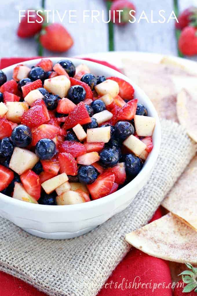 The Festive Fruit Salad has cut apples, strawberries, and blueberries.