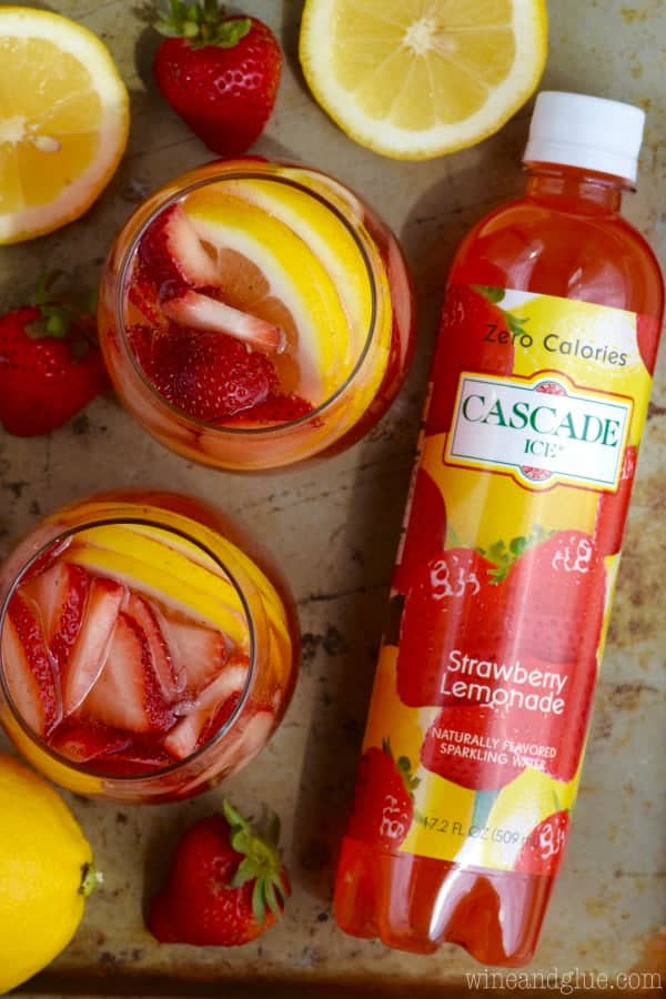 These Strawberry Lemonade Spritzers are FOUR easy ingredients! Such a perfect easy, and light cocktail!