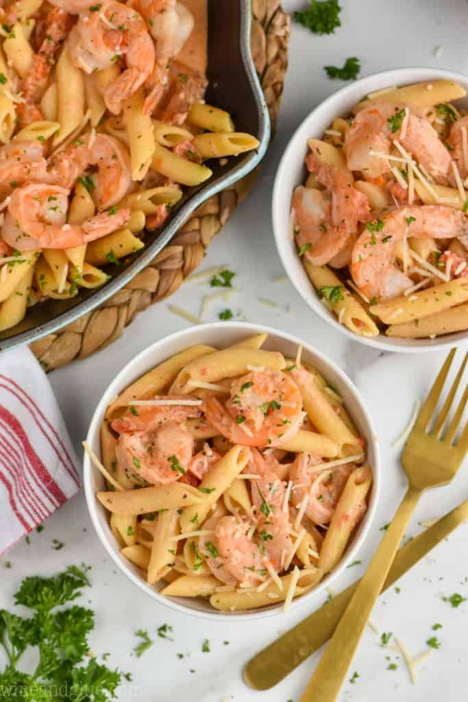 overhead view of one pot cream shrimp pasta recipe in bowls