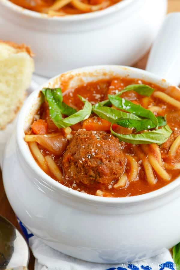 This Slow Cooker Spaghetti and Meatball Soup is easy to throw together, totally hearty, and ultimate comfort food waiting for you when you get home.