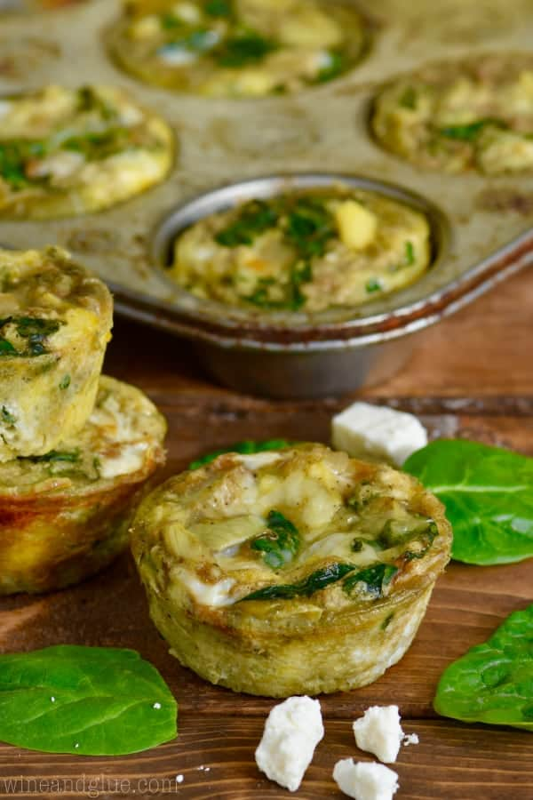 These Spinach and Artichoke Egg Muffins come together fast and you can freeze them for an easy breakfast on the run!