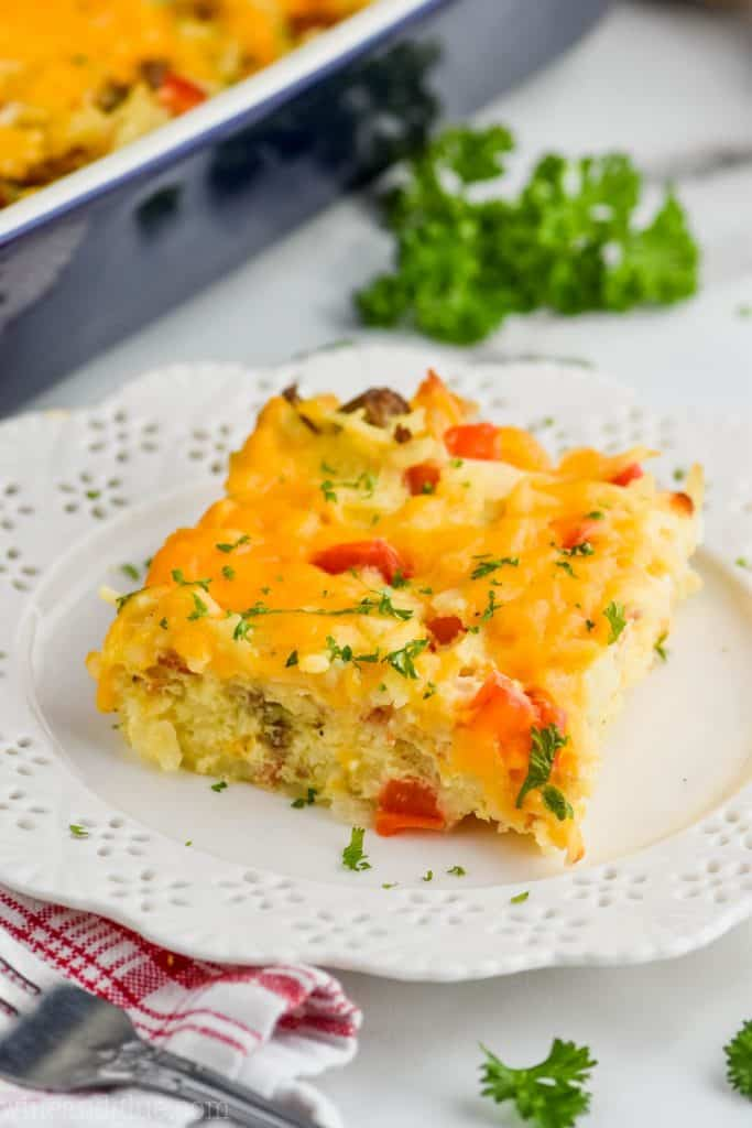 square piece of sausage hash brown casserole on a white plate