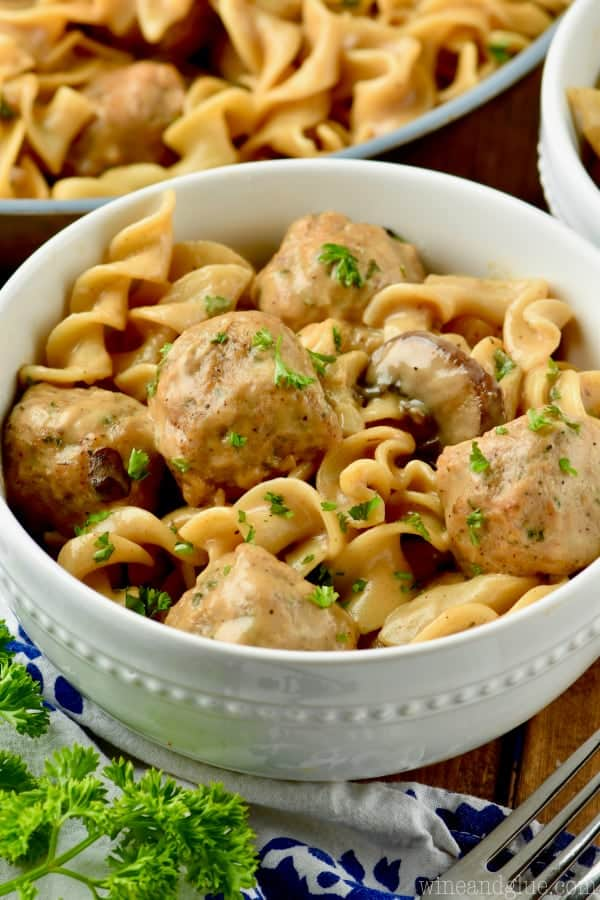 bowl of meatball stroganoff garnished with parsley