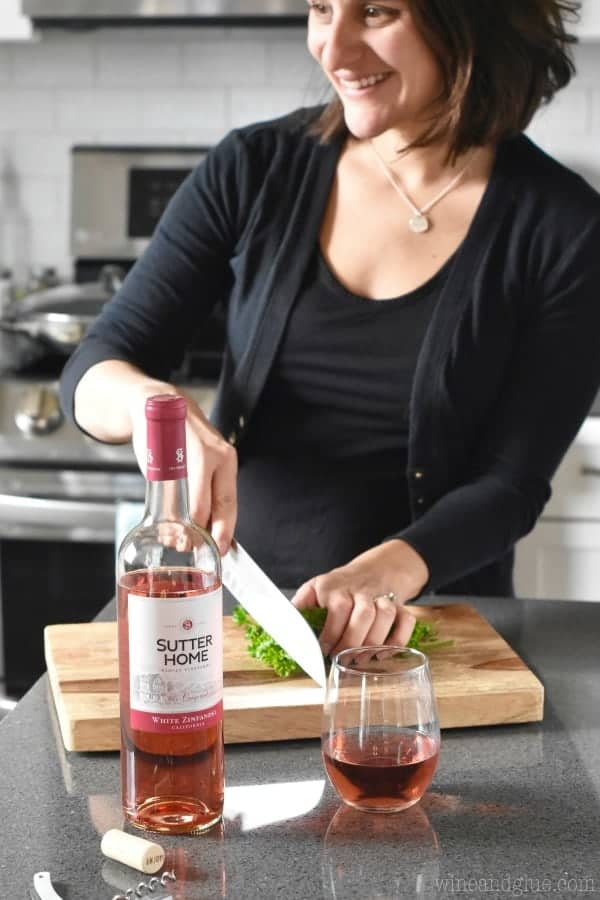 woman in the kitchen with a glass of Sutter Home White Zinfandel wine