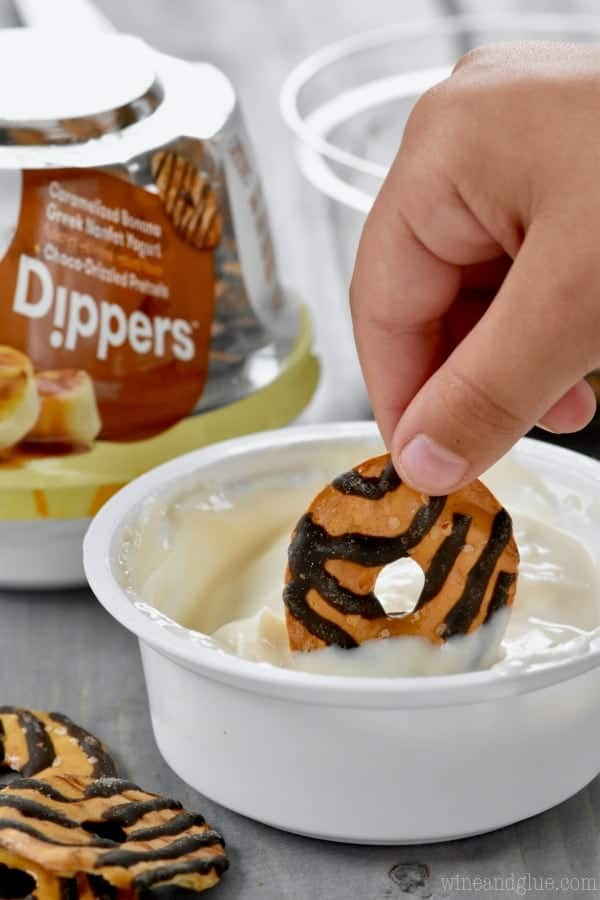 A woman dipping Yoplait's newest snack Dippers into the sauce