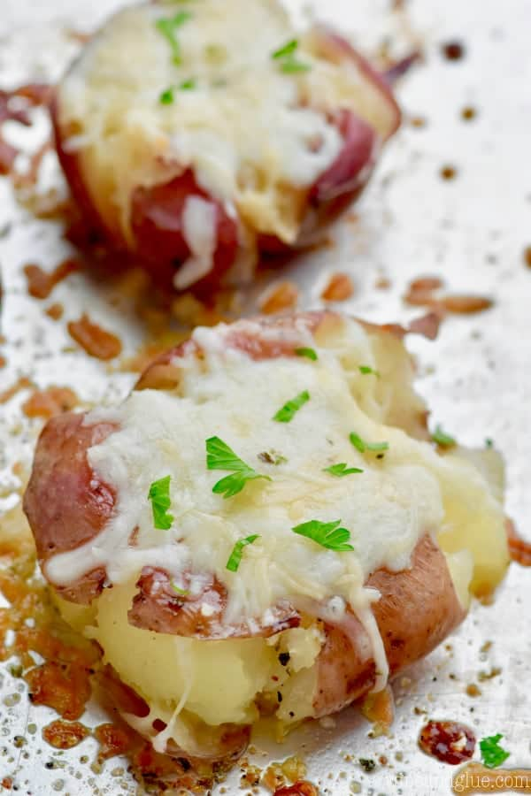 These Italian Roasted Smashed Potatoes are easy, loaded with garlic, butter, and cheese, and seasoned perfectly.  They are a great side dish for any night because they involved so little hands on time!