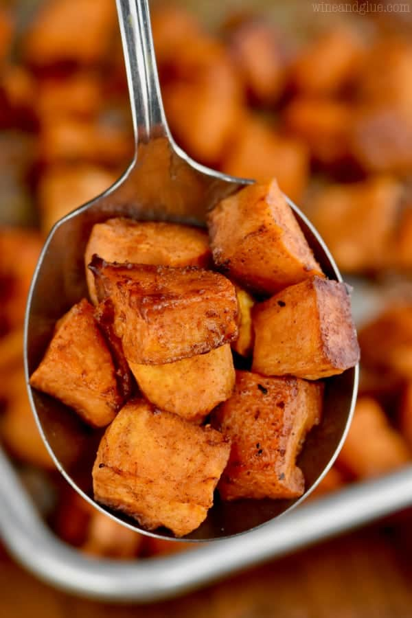 brown sugar roasted sweet potatoes being spooned up