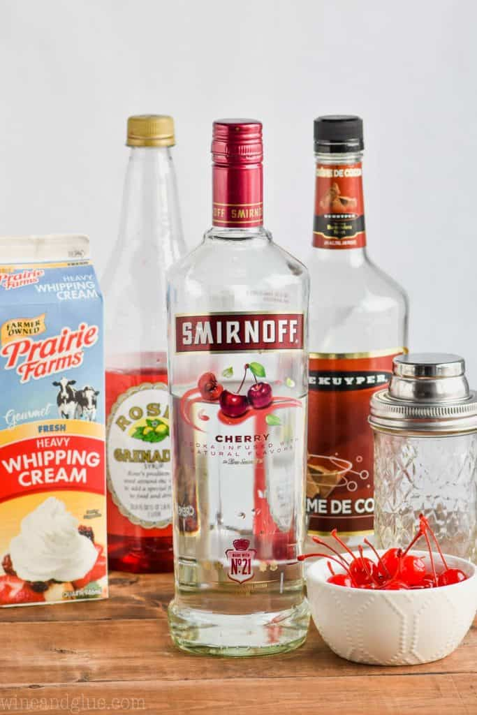 the ingredients for how to make a chocolate covered cherry martini