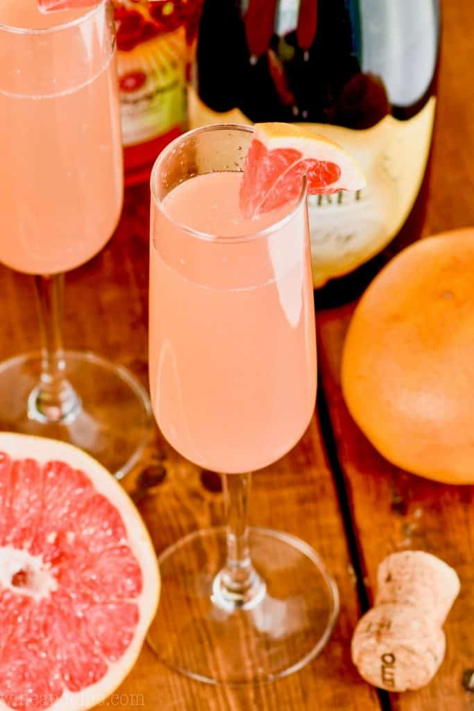 overhead view of a champagne glass filled with pink grapefruit champagne cocktail
