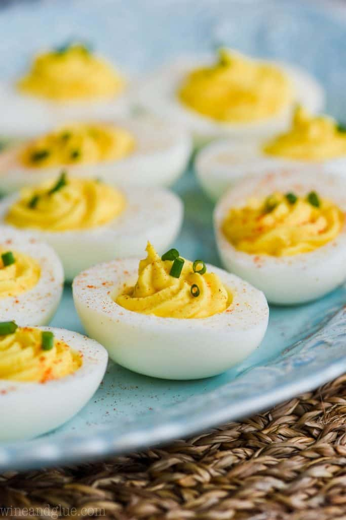 side view of a blue platter of deviled egg recipe