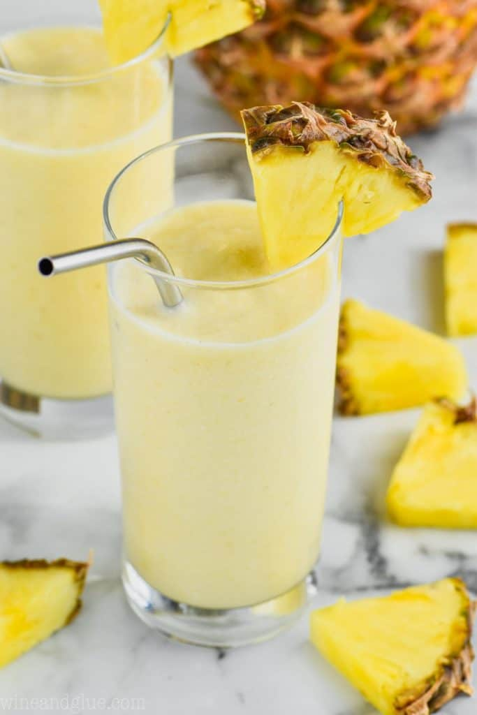 Rum Dole Whip in a glass with pineapple chunks