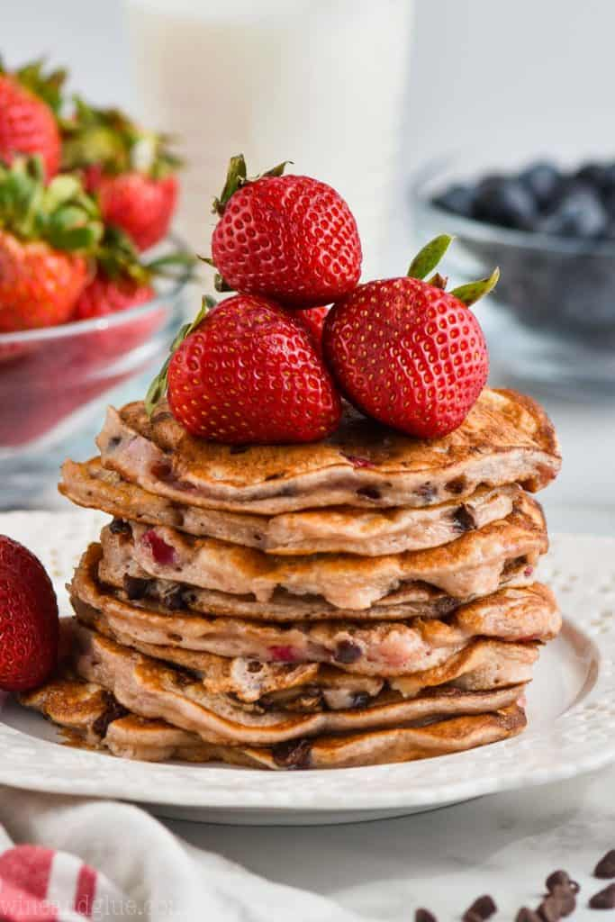 stack of strawberry chocolate chip pancakes with strawberries on top