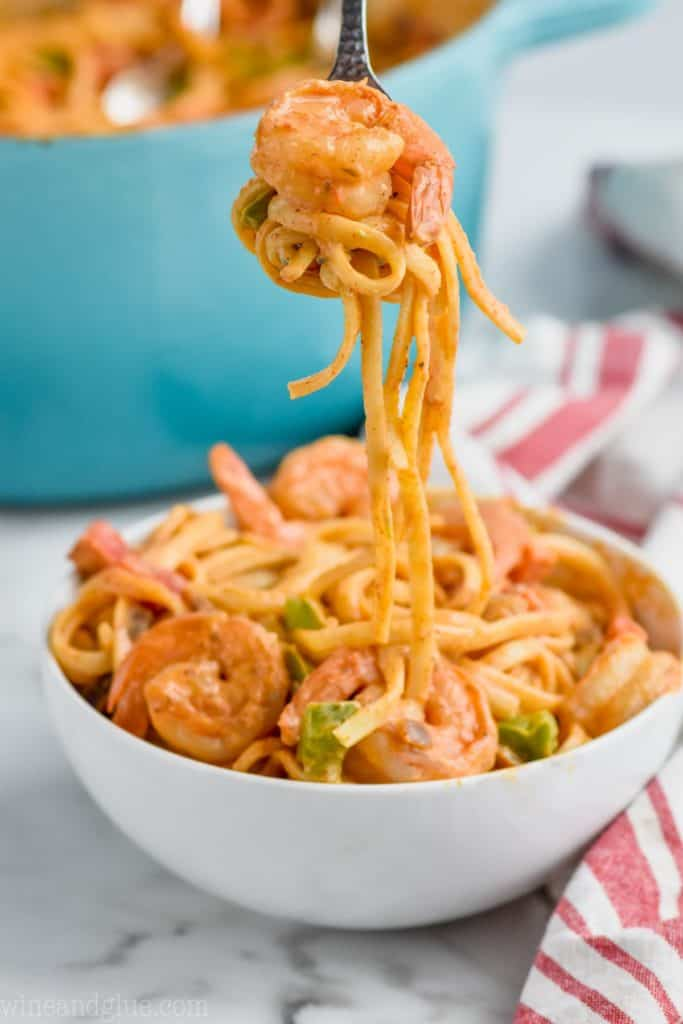 bowl of one pot shrimp fajita pasta with forkful coming out