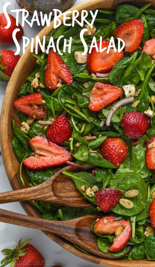 overhead view of strawberry spinach salad in wooden bowl