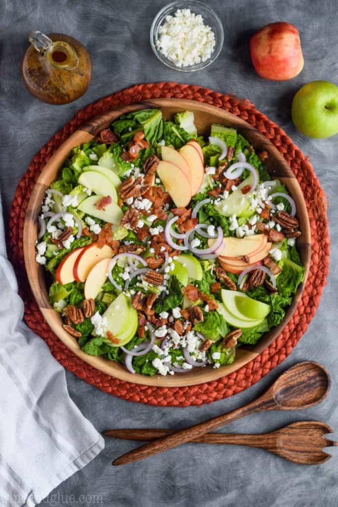 overhead view of apple bacon salad with goat cheese and nuts