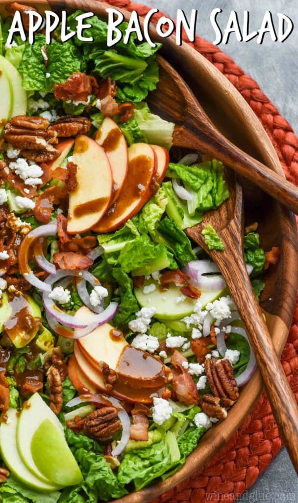 overhead view of apple bacon salad with apples, goat cheese, and pecans