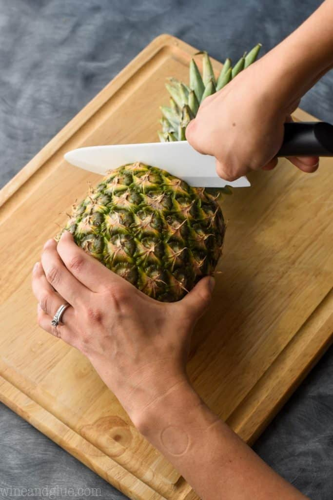 a pineapple with the top being cut off