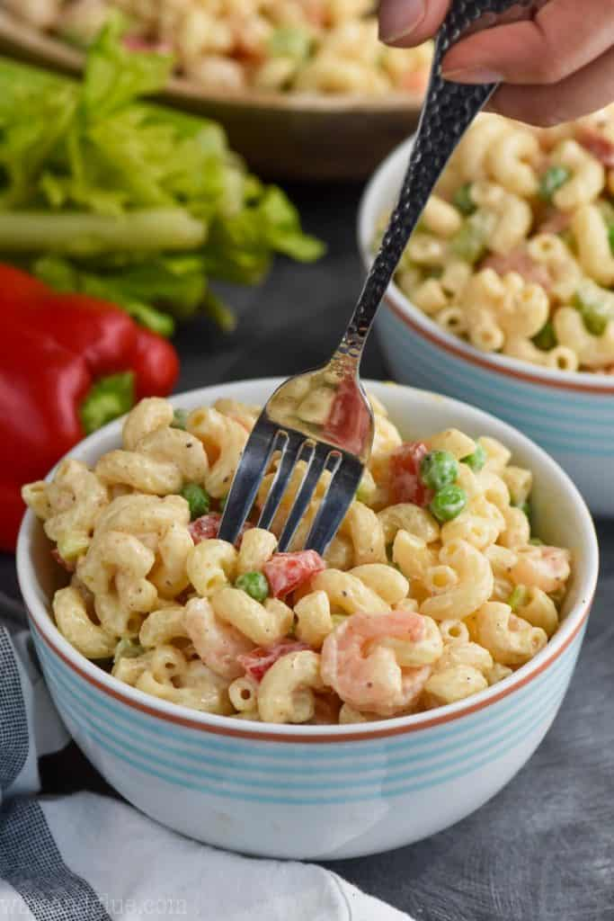 fork in a bowl of the best shrimp pasta salad recipe
